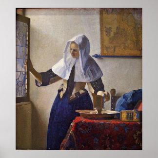 Mujer con una jarra del agua. por Juan Vermeer Posters