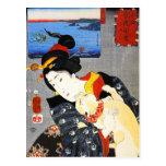 Mujer de Kuniyoshi con una postal del gato