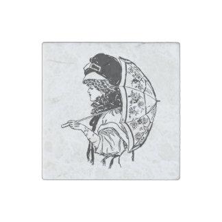 Mujer de la regencia del Victorian con el retrato Imán De Piedra