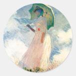 Mujer de Monet con los pegatinas de un parasol Etiqueta Redonda