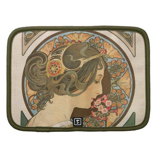 Mujer del nouveau del arte con las flores planificadores