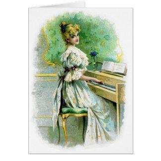 Mujer del Victorian que juega el piano Tarjetas