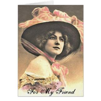 Mujer del vintage con el gorra