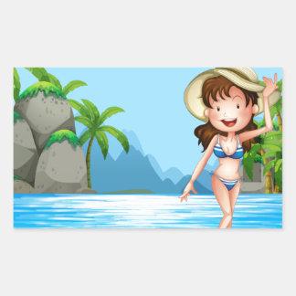 Mujer en bikini en la playa pegatina rectangular