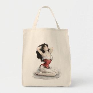 Mujer en corsé rojo bolsa tela para la compra