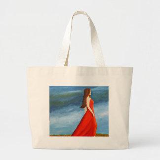 Mujer en el vestido rojo bolsa
