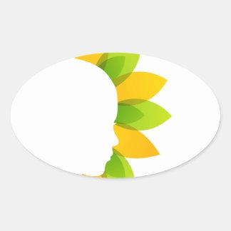 Mujer en las hojas del verde y del amarillo pegatina ovalada