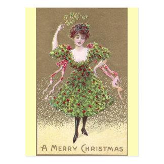 Mujer en vestido del acebo con navidad del muérdag postales