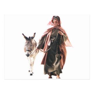 Mujer hebrea con el burro la tarjeta de la entrada postales