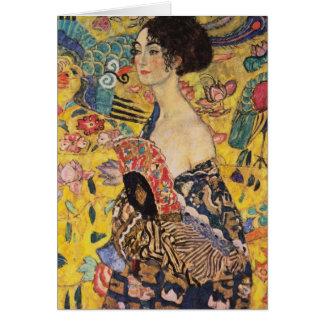 Mujer hermosa con la fan por Klimt Felicitacion