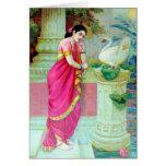 Mujer india en sari en templo con el cisne felicitacion