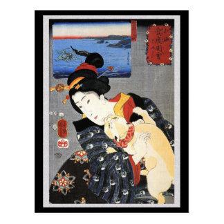 Mujer japonesa que sostiene el gato postal