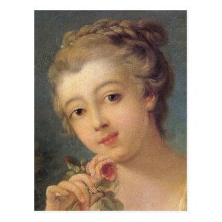 Mujer joven con un ramo de rosas detalladamente tarjetas postales