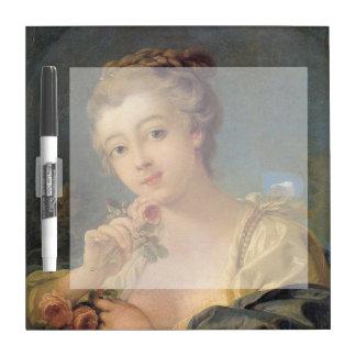 Mujer joven con un ramo de rosas pizarras