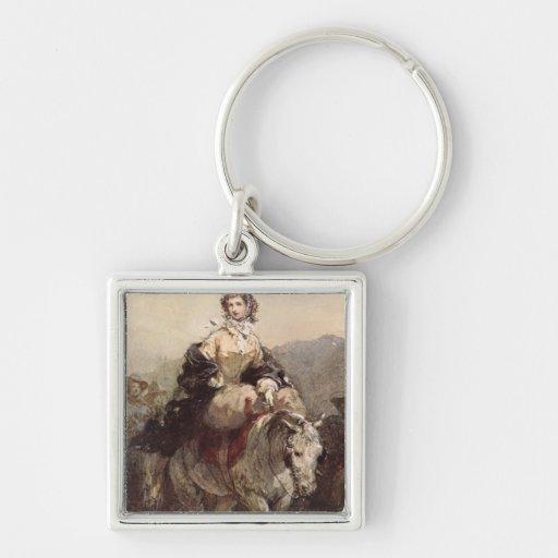 Mujer joven en un caballo llavero