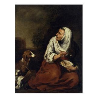 Mujer mayor con el perro postal