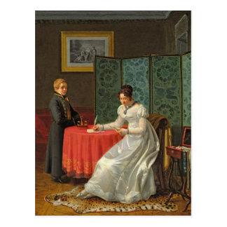 Mujer que escribe una letra postal