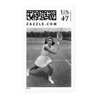 Mujer que juega a tenis timbres postales