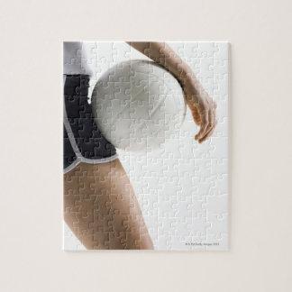 mujer que juega a voleibol puzzles con fotos