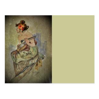 Mujer que toca el instrumento atado tarjetas postales