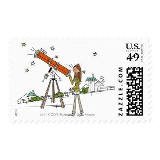 Mujer que usa un telescopio de la astronomía timbres postales