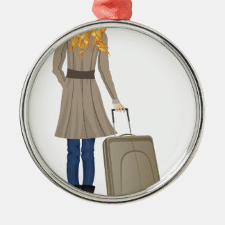 Mujer rubia con la maleta adorno navideño redondo de metal