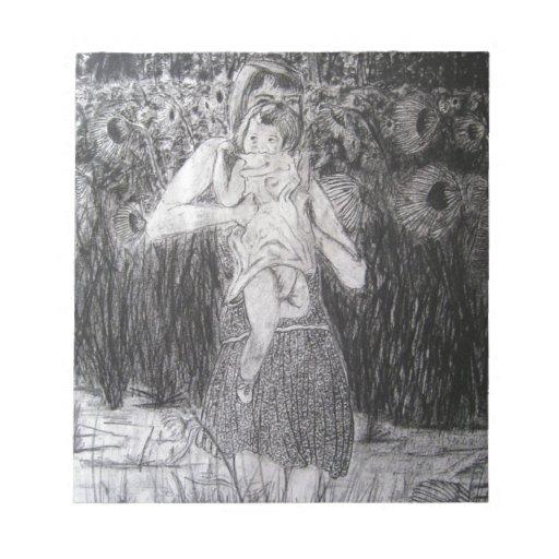 Mujer y niño con los girasoles blocs de papel