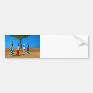 Mujeres africanas coloridas que llevan los cubos pegatina para auto