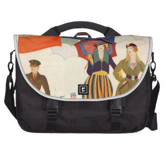 Mujeres de moda del vintage sobre ciudad bolsas para ordenador