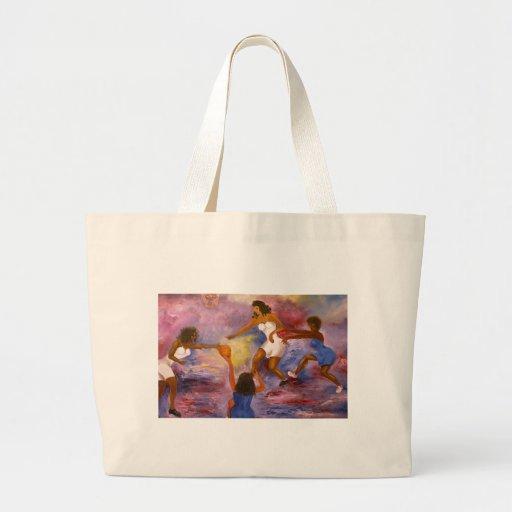 mujeres que juegan la bola de la cesta bolsas lienzo