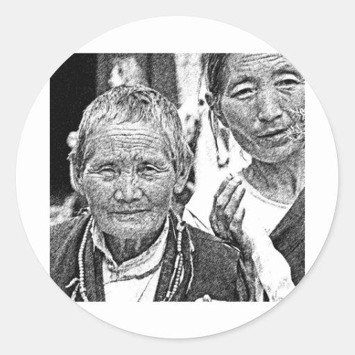 Mujeres tibetanas etiqueta redonda