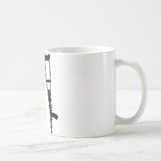 Muletas de la ametralladora - paz de la guerra del taza