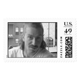 Mullet, moustache, and it looks like a perm. stamps