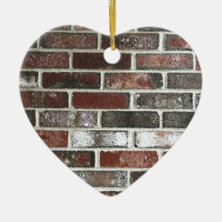 Multi color brick wall with reds, whites and brown ceramic ornament