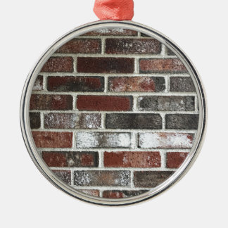 Multi color brick wall with reds, whites and brown metal ornament