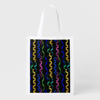 Multi-colored party streamers on a black grocery bags