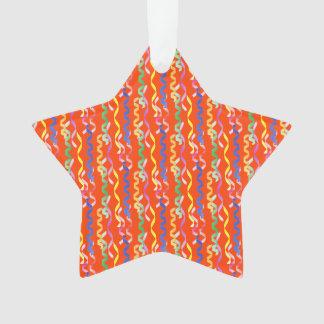 Multi-colored party streamers on a neon orange ornament