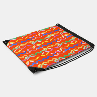 Multi-colored party streamers on a neon orange cinch bag