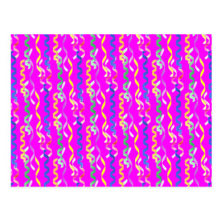 Multi-colored party streamers on a neon pink postcard