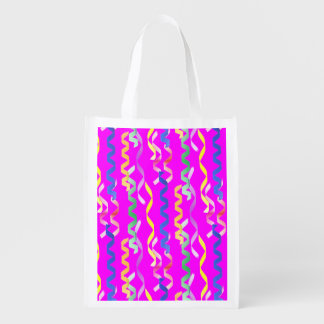 Multi-colored party streamers on a neon pink market tote