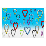 Multi-colored Valentines Hearts on Blue Cards