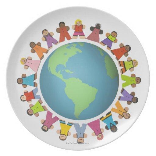 Multi ethnic figurines encircle the globe plates