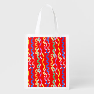 Multi Party Streamers on Neon Red Grocery Bags