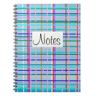 Multicolor check stripes pattern on blue notebook