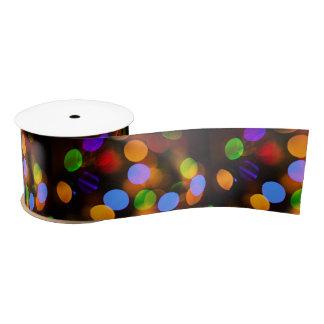 Multicolored Christmas lights. Satin Ribbon