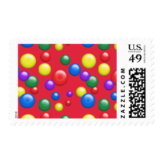 Multicolored Gumballs on Red Postage