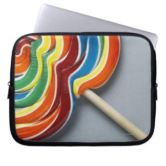 Multicoloured lollipop, close-up laptop sleeves