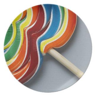 Multicoloured lollipop, close-up party plate