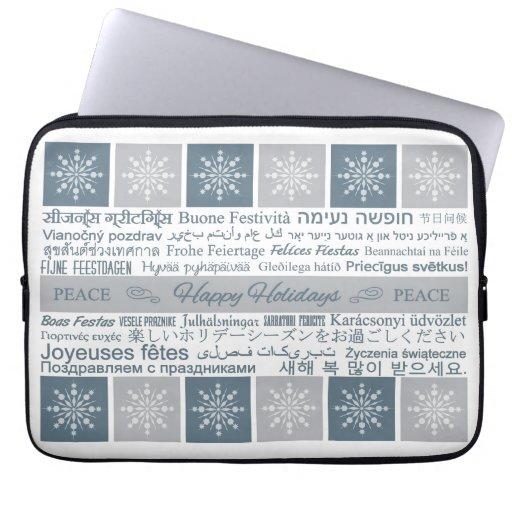 Multilingual Happy Holidays laptop sleeves