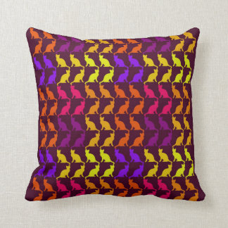 Multiple colorful cats on deep raspberry pillow